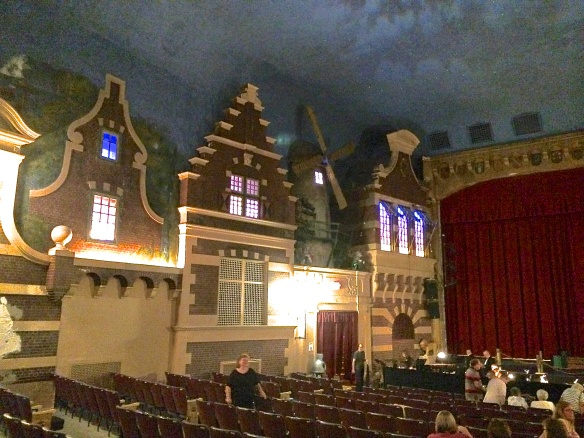 Recent photo of the interior of the Holland Theater with it's painted sky, starlight and turning windmill blades