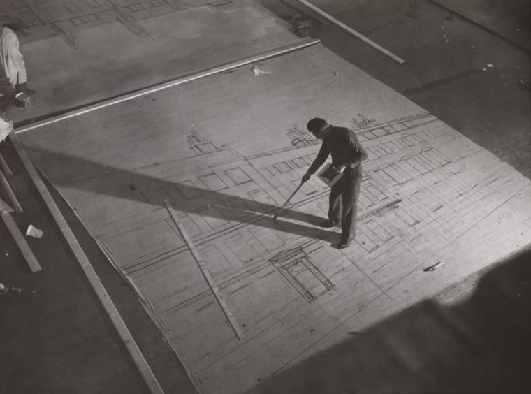 "A scenic lays out a backing at Ealing Studios in London in 1939 for the film ""Young Man's Fancy"". National Media Museum"