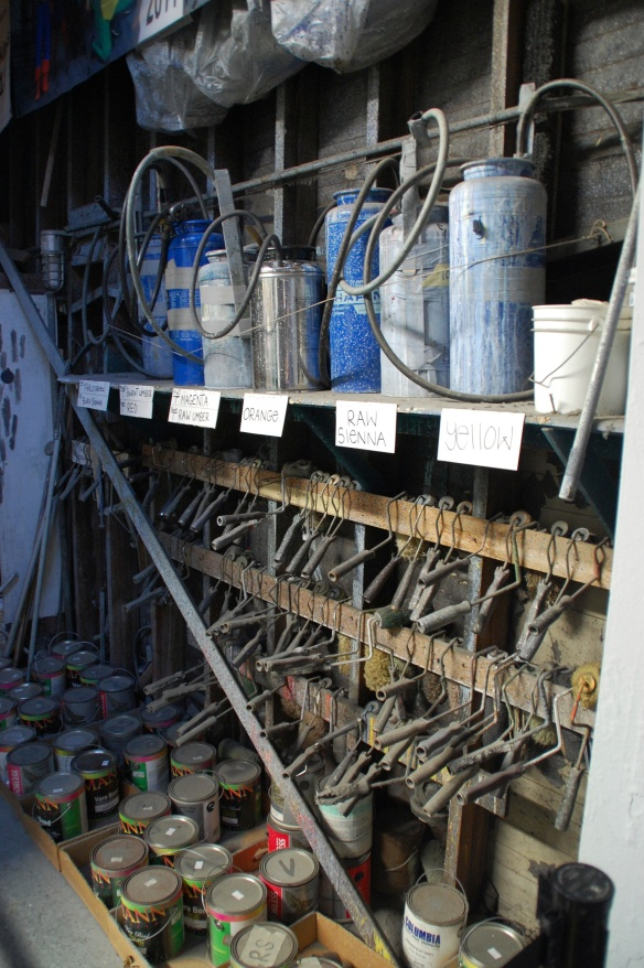 Paint rack with Hudson sprayers and roller mandles